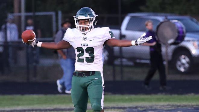 Trinity's Geremiah Smith (23) celebrates a 39-yard touchdown run at Male High School.Sep. 8, 2017