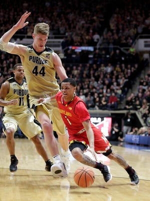 Maryland guard Anthony Cowan (1) drives past Purdue center Isaac Haas (44) during the first half of an NCAA college basketball game in West Lafayette, Ind., Wednesday, Jan. 31, 2018. (AP Photo/Michael Conroy)
