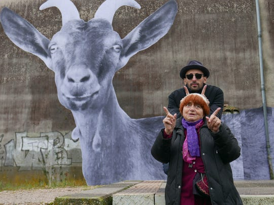 "Film director Agnès Varda and visual artist JR goof around at a goat farm during their road trip in ""Faces Places."""