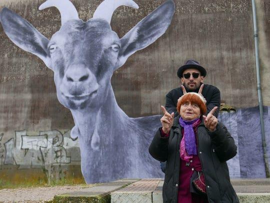 Film director Agnès Varda and visual artist JR goof
