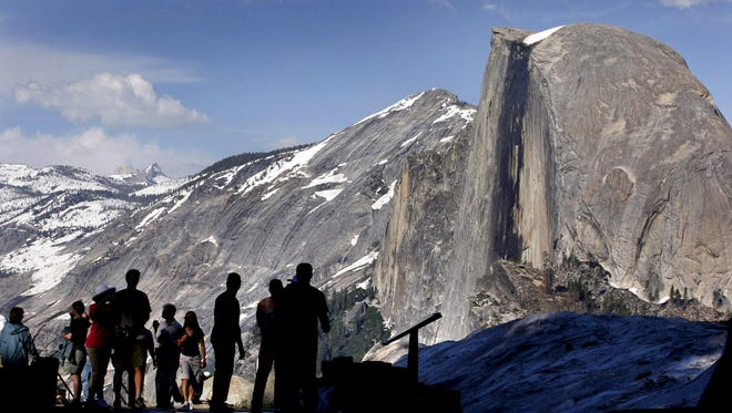In this 2005 file photo, visitors view Half Dome from Glacier Point at Yosemite National Park, Calif.