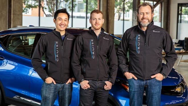 From right, General Motors President Dan Ammann, with Cruise Automation co-founders Kyle Vogt and Daniel Kan
