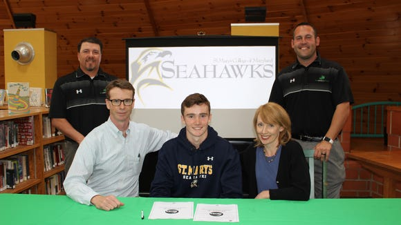 Jack Conway (center), committed to play men's lacrosse at Division III St. Mary's College last week.