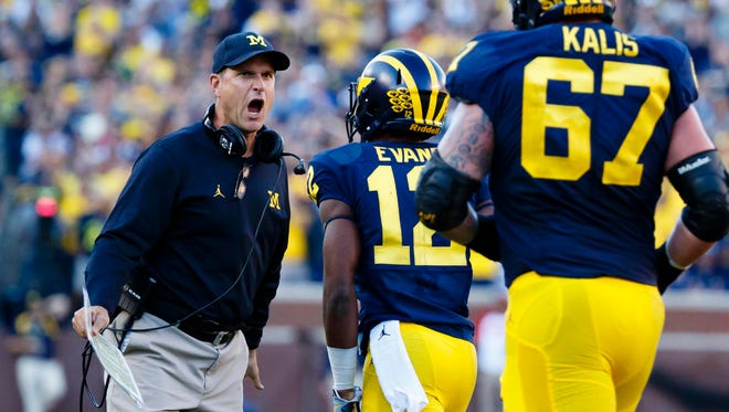 The Badgers face No. 5 Michigan, led by coach Jim Harbaugh, in Ann Arbor, Mich., on Saturday.