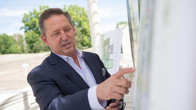 Chip Bowlby showing plans for Rancharrah housing development.