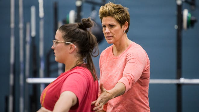 Tash Weddle, right, founder of New Beginnings, leads a fitness class at the center on Craighead Street in Nashville. New Beginnings offers fitness classes and nutritional education and coaching to low income women.