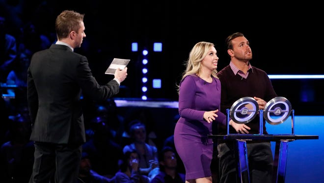 """""""The Wall"""" host Chris Hardwick (left) with Sharon and Lenny Gerome of Brick on the June 29 episode of the NBC series."""