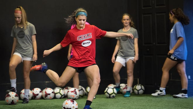 Hannah Nix, 16, kicks a ball while at 11.11 Training, an elite soccer training facility for girls in Greenville, on Tuesday, October 17, 2017.