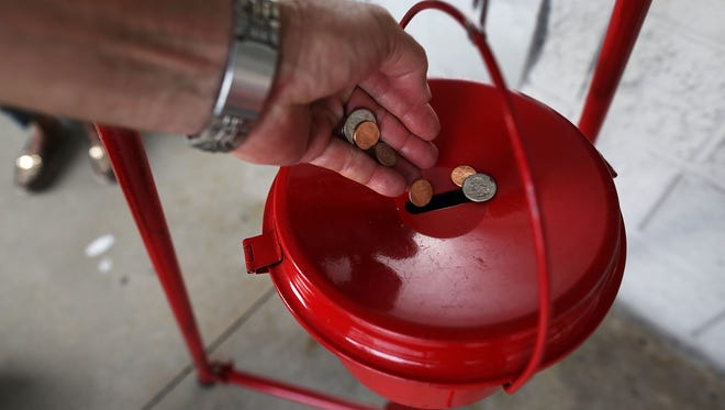 A donation is made into a Salvation Army  red kettle on Giving Tuesday on November 28, 2017 in Hallandale, Florida.