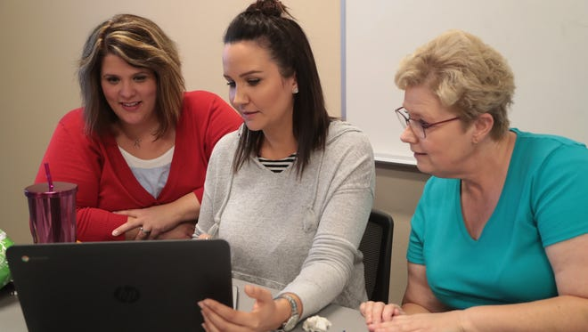 DIGICOM instructor Jessica Pack, left, works with Katee Dean on a video as Cindy Martinez long on. Dean and Martinez are participating in DIGICOM's video production training program for Palm Springs Unified teachers, Palm Springs, Calif., June 13, 2018.