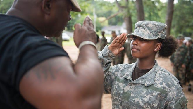 Xenoshha Tate, 12, salutes Drill Sergeant Steven Sullivan at the beginning of bootcamp on Thursday, June 14, 2018.