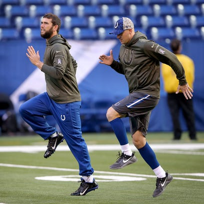 Indianapolis Colts quarterback Andrew Luck (12) and Matt Hasselbeck (8) get loose during their pre game warm ups.  The Indianapolis Colts play the Denver Broncos Sunday, November 8, 2015, afternoon at Lucas Oil Stadium.