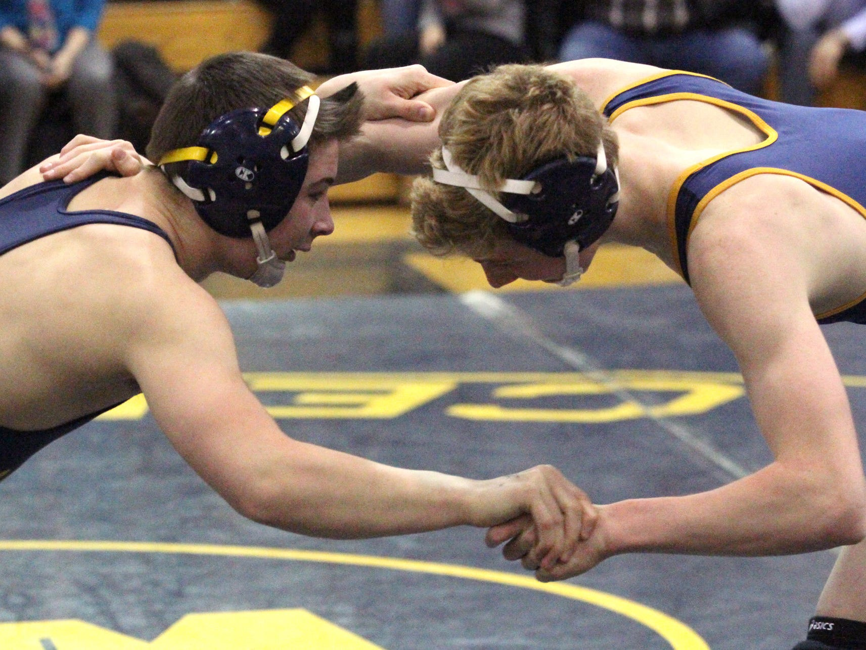 Zach Zoll, seen at 135 pounds against Clarkston in the regional semifinals, and the Eagles won their 14th consecutive regional championship Wednesday night. Hartland beat the Wolves, 61-10, and downed host Walled Lake Central, 34-25, to reach the team state finals.