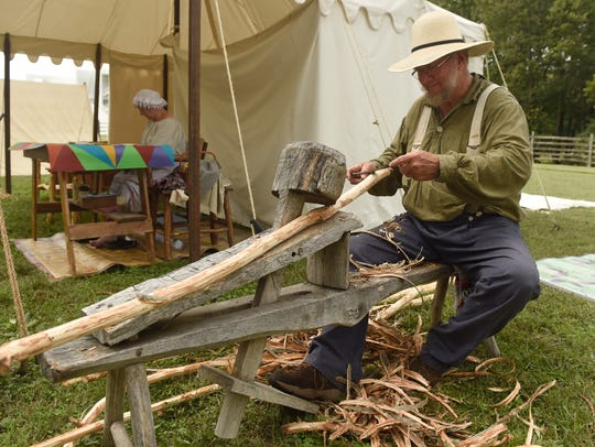 Joe Littrell of Iuka, Ill., sits on a shaving horse