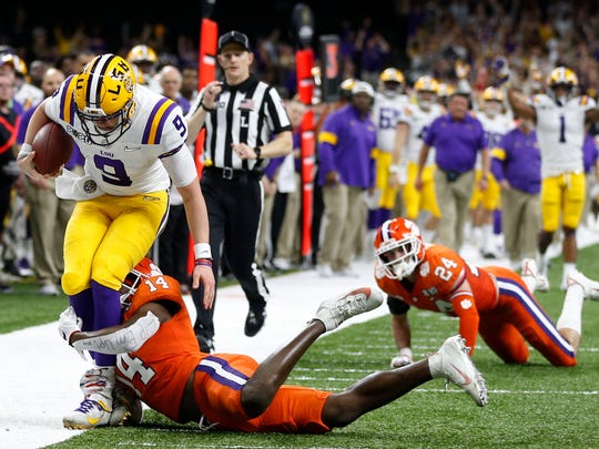 LSU quarterback Joe Burrow is tackled by LSU defensive back Maurice Hampton Jr. during the first half of a NCAA College Football Playoff national championship game Monday, Jan. 13, 2020, in New Orleans. (AP Photo/Gerald Herbert)