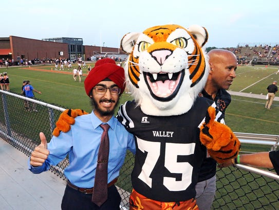 Homecoming King candidate JJ Kapur stops for a picture
