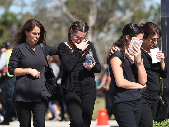 Mourners at the funeral of Alyssa Alhadeff at the Garden