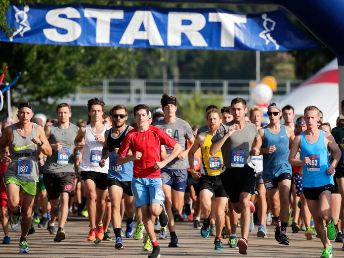 Runners take off from the starting line during the