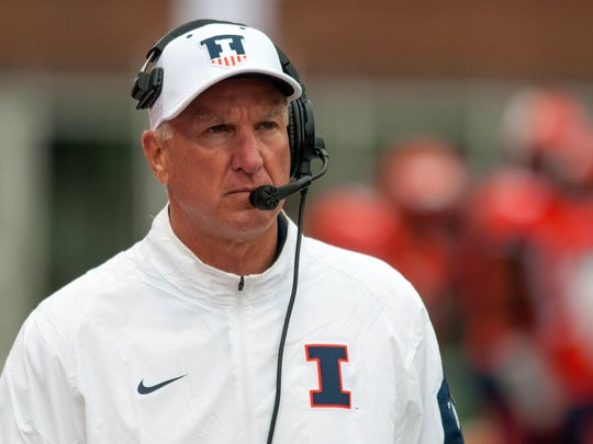 FILE - In this Oct. 3, 2015, file photo, Illinois interim head coach Bill Cubit walks the sidelines during the second quarter of an NCAA football game against Nebraska at Memorial Stadium in Champaign, Ill. New Illinois athletic director Josh Whitman has fired first-year football coach Bill Cubit, saying the program needs a new coach to work toward long-term success. Whitman says in a news release Saturday, March 5, 2016, he appreciated Cubit's work as interim coach last season after the firing of Tim Beckman.  (AP Photo/Bradley Leeb)