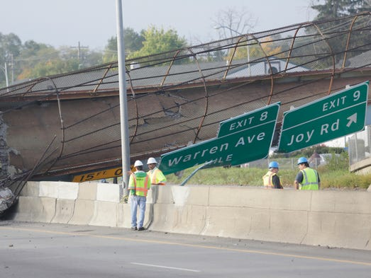 MDDOT workers at the scene of the Cathedral Bridge collapse over the Southfield Freeway. A truck hit the bridge early Friday morning causing the collapse and killing its driver.