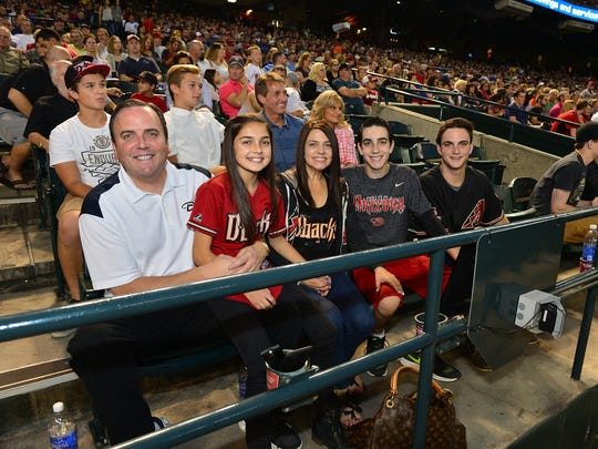 Arizona Diamondbacks president Derrick Hall, wife, Amy, and family enjoy a game at Chase Field in Phoenix.