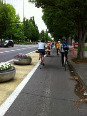 Portland tries to make biking on the roads more comfortable by separating bicyclists from traffic with planters.