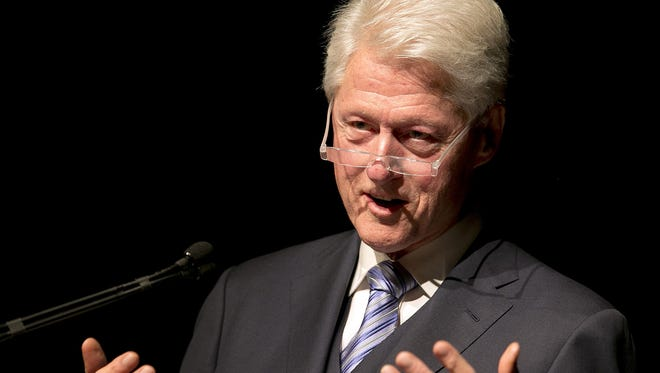 Former President Bill Clinton addresses the audience on the second day of the Civil Rights Summit at the LBJ Presidential Library April 9, 2014 in Austin, Texas.