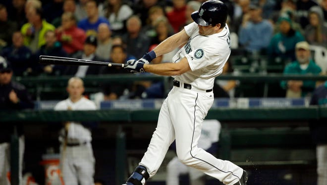 Seattle Mariners' Seth Smith hits a two-run home run against the Los Angeles Angels in the second inning of a baseball game, Monday, Sept. 14, 2015, in Seattle. (AP Photo/Ted S. Warren)