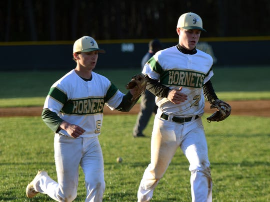 Wilson Memorial pitcher Jack Wingfield, left, thanks shortstop Gage Wood after he threw out a Stonewall Jackson runner to end the fifth inning of the Green Hornets' 4-2 victory over the Generals in Shenandoah District baseball action on Tuesday, April 17, 2018, at Bo Bowers Stadium in Fishersville, Va.