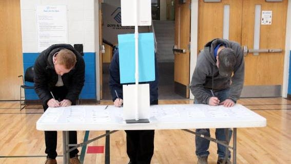 Voters prepare to vote on Nov. 7, 2017 at the Boys and Girls Club of Holland.