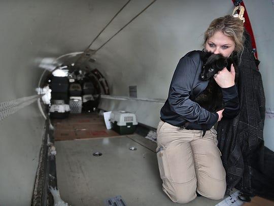 West Memphis Animal Control officer Rachel Bybee cuddles