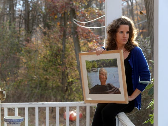 Nancy Montgomery holds a photo of her husband, Jim Lovell, an NBC sound technician who was killed aboard the Metro-North train that derailed at Spuyten Duyvil on Dec. 1, 2013. Montgomery, photographed Nov. 16, 2017 at her home in Cold Spring, continues to attend MTA meetings in order to hold Metro-North accountable for the crash.