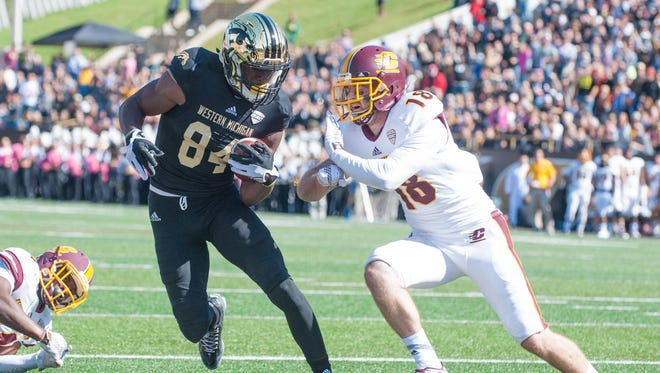 Western Michigan University receiver Corey Davis (84) runs into the endzone as Central Michigan defensive back Tony Annese (18) gives chase during their 2015 matchup.