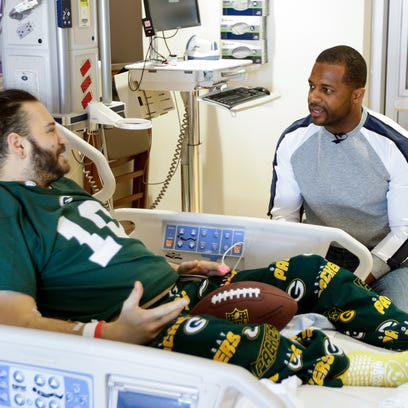 Randall Cobb visits with Damien Garza of Watertown