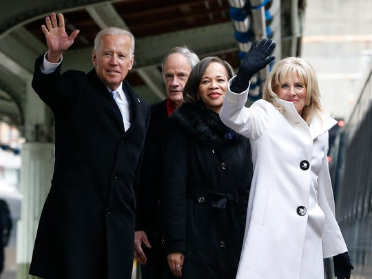 Delawareans (from left) Vice President Joe Biden, Senator Tom Carper, Congresswman Lisa Blunt Rochester and Dr. Jill Biden wave to the press as they get on an Amtrak Acela train at Union Station bound for Wilmington after attending inauguration events Friday.