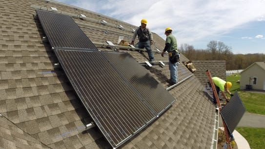 Solar panels are installed on a house in Walden, N.Y.