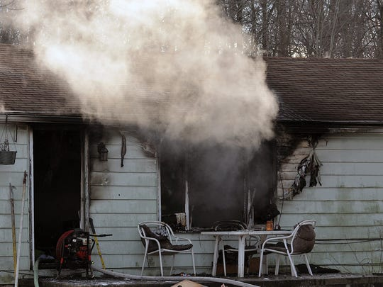 Smoke bellows out of the residence at 1129 Nestor Drive.