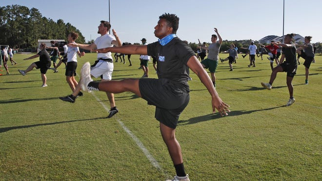 Flagler Palm Coast high school football players run drills Monday during their first practice at the school. Coronavirus precautions stopped local high school sports in March.