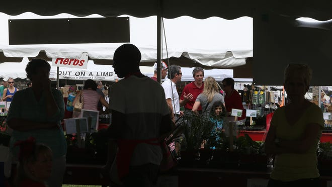 Business was steady at the flower tents at the Wilmington Flower Market's final day Saturday.