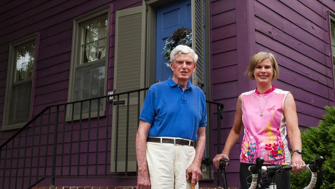 Beth Friedman poses for a portrait with her father Tom McDowell outside of his home in New Castle on Thursday afternoon, August 21, 2014.