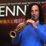 In this 2010 file photo, Kenny G, smooth jazz saxophonist, performs during a media event announcing his concert, in Taipei, Taiwan. Kenny G stopped in at Hong Kong's pro-democracy protests on Wednesday, Oct. 22, 2014, but his visit was out of tune with Chinese authorities, who have warned about meddling by foreign forces.