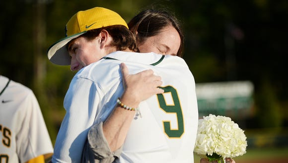 Anne Baumstark hugs her son, Jimmy, during Reynolds'