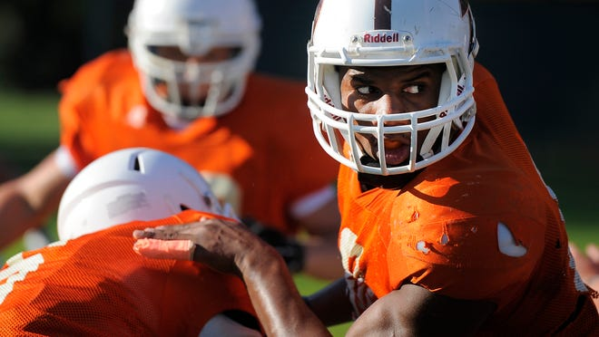 DeSales defensive end Bryant Pirtle runs through plays during a practice.