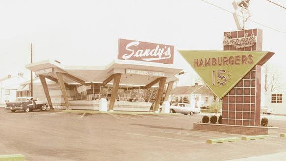 In 1960, Don Crawford, a Hutch Realtor, purchased Sandy's franchise #11 and built a new store at 2609 N. Main across from his real estate offices.