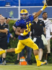 Blue's Quadree Henderson of A.I. du Pont coasts into the end zone with the eventual game-winning touchdown on a hook and lateral play late in the fourth quarter of the DFRC Blue-Gold game at Delaware Stadium Saturday.