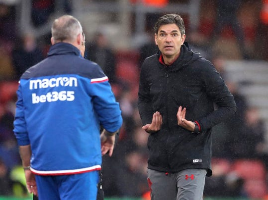 Southampton manager Mauricio Pellegrino, right, appeals to an official during the English Premier League soccer match between Southampton and Stoke City, at St Mary's Stadium in Southampton, England, Saturday March 3, 2018. (Adam Davy/PA via AP)