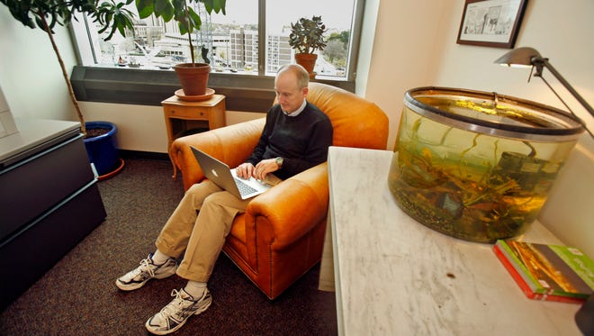 University of Wisconsin-Madison developmental biologist James Thomson responds to e-mails in his office in October, 2008.