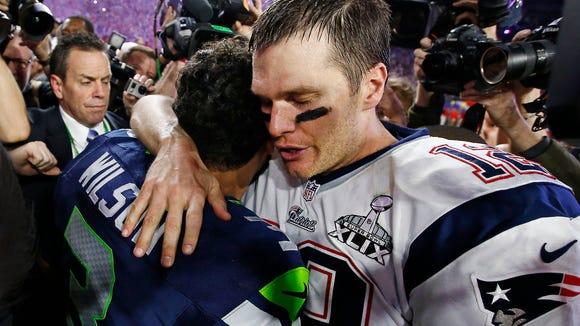 New England Patriots Tom Brady hugs Seattle Seahawks Russell Wilson at Super Bowl XLIX on Sunday, Feb. 1, 2015 in Glendale, AZ.