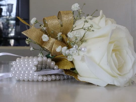 Corsages, like this one from Tove's Flowers and Boutique is a cost to consider when planning for prom.