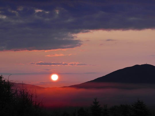 In this file photo, Lindsay Carpenter took this shot of sunrise over Burke Mountain from her deck in Lyndonville.